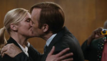 Kim and Jimmy kissing in front of a judge